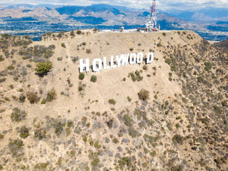 The Hollywood sign with the San Fernando valley behind it located in California, USA