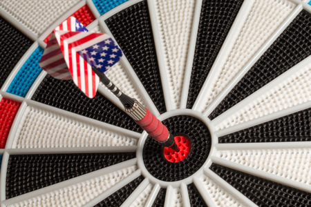 Close-up of dart in the bullseye with a USA tail. photo