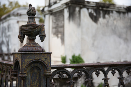 sconce: New Orleans Saint Louis Cemetery   Old and rusty wrought iron corner post and fence  Stock Photo