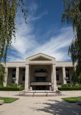 carson city: Nevada Supreme Court building in Carson City, the Nevada state capital.  Set against a blue sky.  Vertical orientation.