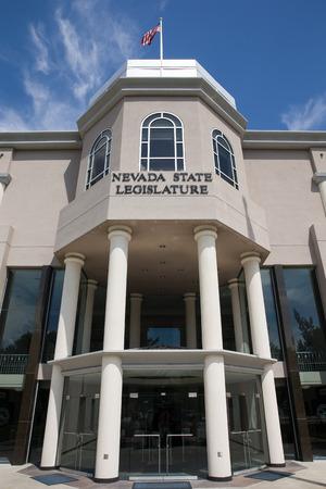 carson city: Nevada State Legislature building in Carson City, the Nevada state capital.  Set against a blue sky.  Vertical orientation.