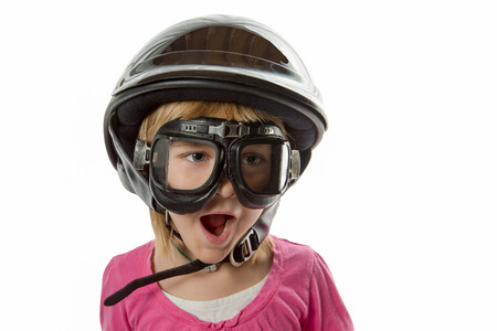 Prepared - Expressive girl with helmet and goggles.  Shock and surprise.  Isolated on white. photo