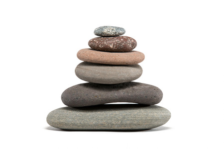 Stone cairn made from a variety of colorful Lake Superior rocks.  Studio shot isolated on white.