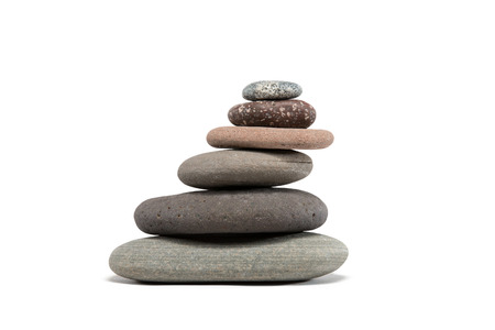 slanting: Slanting stone cairn made from a variety of colorful Lake Superior rocks.  Studio shot isolated on white.