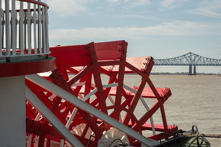Looking at red paddlewheel and back at the Crescent City Connection bridge, the farthest downstream bridge on the Mississippi River.  Copy space in upper part of frame.