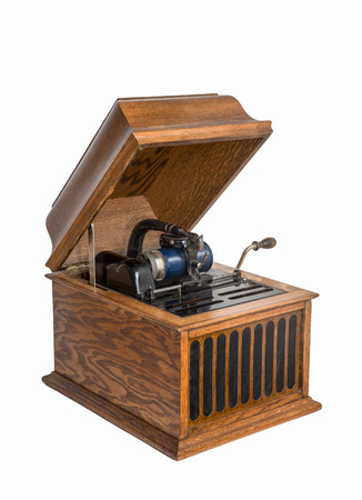 Vintage tabletop cylinder phonograph circa 1920. Blue celluloid cylinder. Isolated on white. Reklamní fotografie