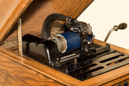 antique phonograph: Close up of antique tabletop cylinder phonograph mechanism with blue celluloid cylinder.  Vintage technology circa 1920.