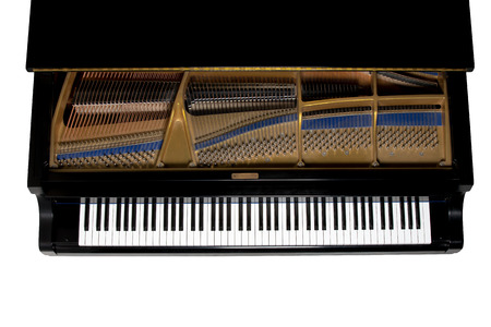 Grand piano.  Close up showing keys, harp, and hammers.  Viewed from above.  Isolated on white. Stock Photo