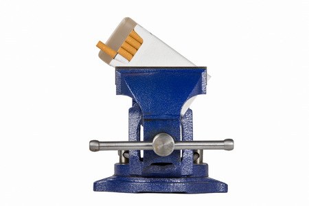 vise grip: Pack of cigarettes held in a blue vise grip.  Isolated on white.  Concepts could include vice in a vise, dealing with a crushing addiction, trapped by health issues, or others.