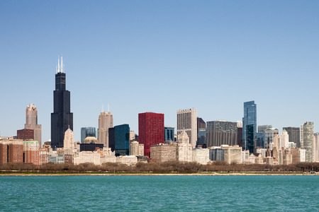 chicago: Chicago Skyline captured on a sunny spring morning showcasing the citys skyscrapers and varied architectural styles.  Room for your copy in the clear blue sky if needed.