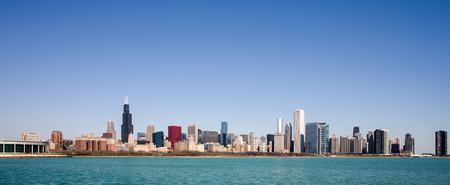 Chicago Skyline panorama captured on a sunny spring morning showcasing the citys skyscrapers and varied architectural styles.  Room for your copy in the clear blue sky if needed.