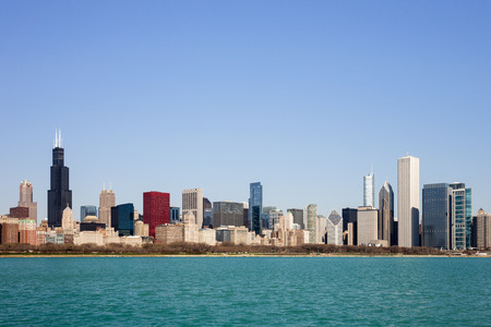 Chicago Skyline captured on a sunny spring morning showcasing the citys skyscrapers and varied architectural styles.  Room for your copy in the clear blue sky if needed.