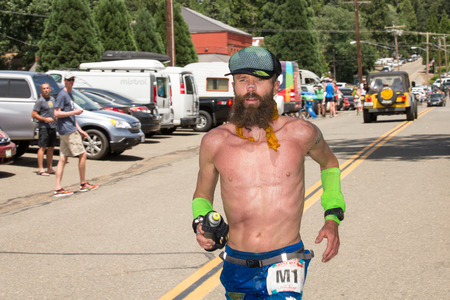 Elite ultra-marathon runner Rob Krar running in the Western States 100-mile Endurance Run.  Western States is one of the oldest and most popular ultra-marathons in the United States.  Krar won in 2014 and 2015.  Editorial Use Only.