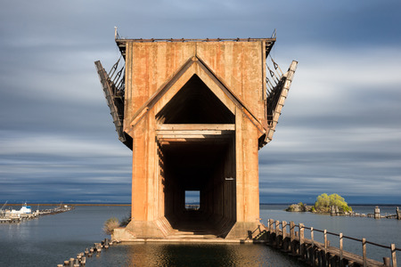 marquette: Abandoned ore dock once used to transfer coal and other materials between railroad cars and Lake Superior ore boats.  Interesting geometric structure captured near sunset.  Warm light and a dramatic sky.
