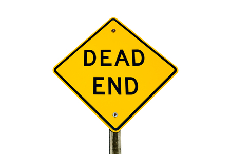 dead end: Photograph of a yellow Dead End sign isolated on a white background.  Sign is mounted on a wooden post.