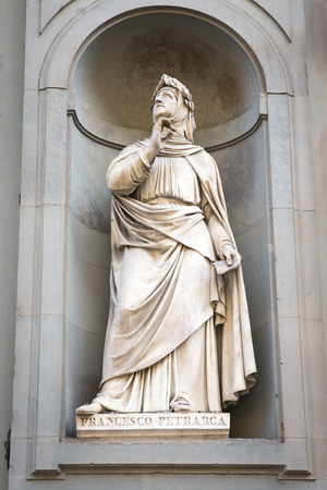 initiating: Statue of Italian poet and scholar Francesco Petrarca outside of the Uffizi Gallery in Florence, Italy.  Petrarca is often credited for initiating the 14th-century Renaissance.  Concepts could include history, art, poetry, and others. Stock Photo