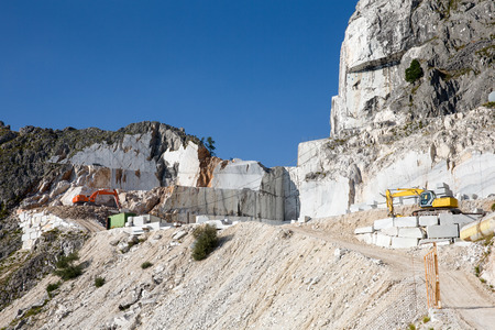 carrara: Working marble mine in the Italian Alps near Carrara in Tuscany in Italy.  Carrara marble is widely recognized for its superior quality. Stock Photo