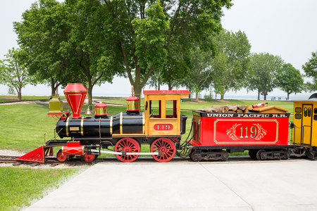 GREEN BAY WI - June 9, 2015:  Narrow gauge train engine at Bay Beach Amusement Park, a popular tourist attraction in Green Bay, Wisconsin.  This is one of three trains used for rides at the park.  It was donated by the Woelbing family, makers of Carmex li