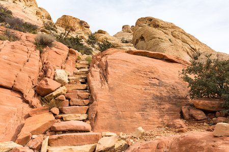 Sandstone steps along a hiking trail in the desert at Red Rock Canyon National Conservation Area near Las Vegas, Nevada.