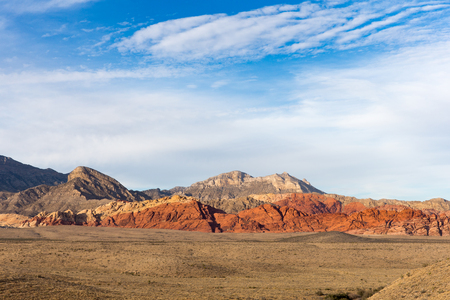 Western landscape showing the Red Rock Canyon hills rising from the desert floor in southern Nevada.  Copy space in the sky if needed.