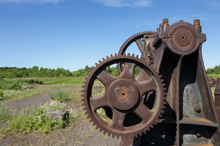 hancock: Rusting industrial equipment with gears.  Part of an abandoned copper mine that is now a Historic National Park in Upper Michigan.  Lots of texture and detail.  Copy space in sky if needed.