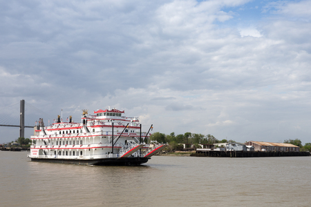 Savannah, GA - March 27, 2017:  The Georgia Queen is an 1800s style paddlewheel riverboat and tourist attraction in historic Savannah, Georgia.  It can accommodate up to 1000 passengers and is the newest member of the Savannah Riverboat Cruise fleet.