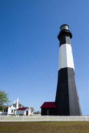 Tybee Island Lighthouse, a historic lighthouse with colonial era ties near Savannah, Georgia.  Vertical orientation with copy space. Stock Photo