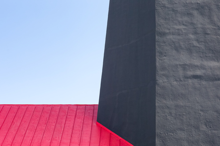 Tybee Island Lighthouse - architectural detail of a historic lighthouse with colonial era ties near Savannah, Georgia.  Red, gray, and blue abstract.