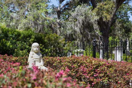 Little Gracie statue in historic Bonaventure Cemetery, Savannah Georgia. The life-size sculpture dates to 1889 and is a well-known Savannah tourist destination. Stock Photo