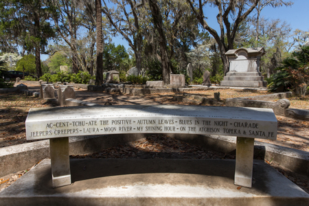 Savannah, GA - March 28, 2017:  Memorial bench at Johnny Mercer gravesite in historic Bonaventure Cemetery, Savannah.  Mercer was a lyricist, songwriter, singer, co-founder of Capital Records, and 4-time Academy Award winner.