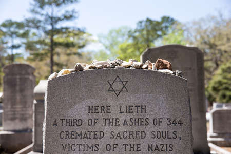 Savannah, GA - March 28, 2017:  Headstone in the Jewish Section of historic Bonaventure cemetery containing Star of David, memory stones, and Holocaust reference.  Savannahs Jewish presence dates to 1733. Editorial