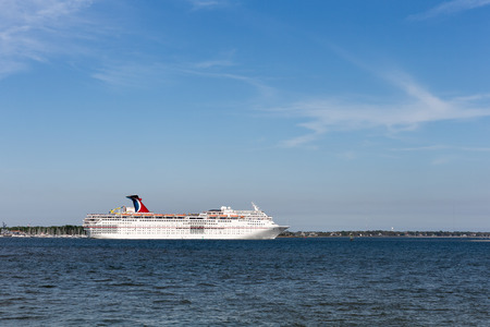 Charleston, SC - March 29, 2017:  Cruise ship leaving historic Charleston, SC.  The Carnival Ecstasy received a major renovation in 2017.  The ship sails to the Bahamas, Bermuda, and the Caribbean. Editorial