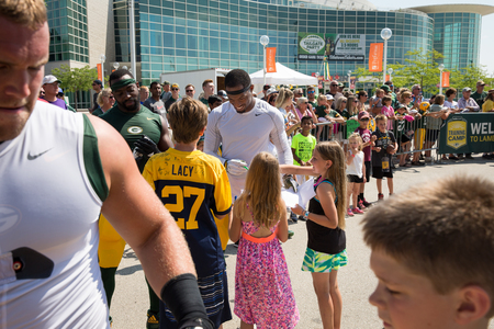 Green Bay, WI - August 1, 2017:  Green Bay Packer Ha Ha Clinton-Dix signs autographs for young fans after football practice.  The community owned team has a long tradition of player involvement with fans. Editorial