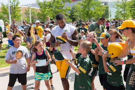 Green Bay, WI - August 1, 2017:  Green Bay Packer DeAngelo Yancey signs autographs for young fans after football practice.  The community owned team has a long tradition of player involvement with fans.