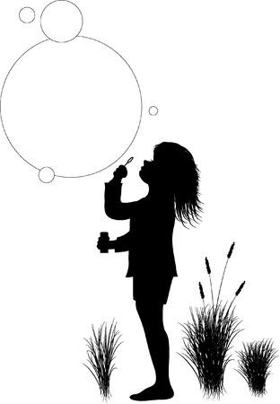 bulles de savon: enfant soufflant des bulles