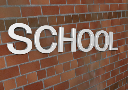 child holding sign: School sign with brick wall Stock Photo