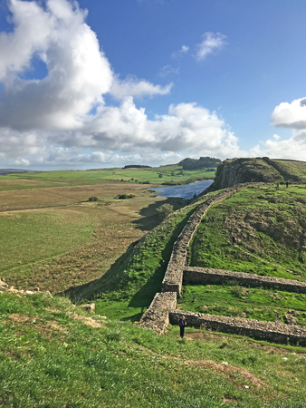Hadrians wall with fort Фото со стока