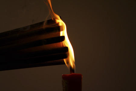 Burning incense sticks on red candle to celebrate the traditional wedding in Chinese photo