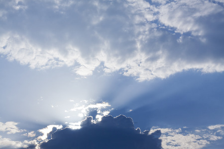 crepuscular: Crepuscular rays blue and white sky