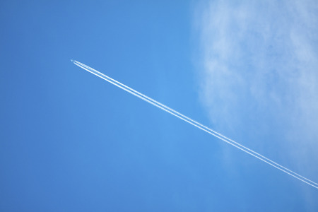 contrail: airplane contrail against clear blue sky Stock Photo