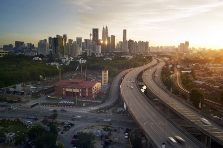 Dramatic scenery of elevated highway heading towards Kuala Lumpur city centre during sunset. Stock Photo