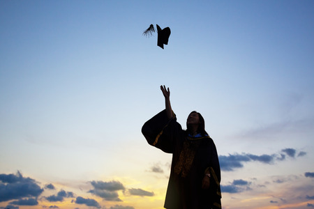 teen silhouette: Silhouette Of Young Female Student Celebrating Graduation