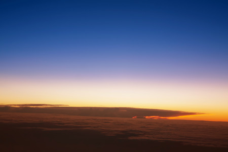 window view: Airplanes window seat view with sunsetsunrise Stock Photo