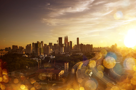 kuala lumpur city: Kuala Lumpur Skyline. Abstract cityscape view  with effect blur, bokeh, light point, color flows. The world of light and color.
