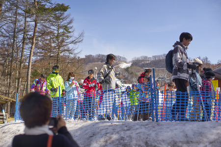 lining up: Karuizawa,Japan - 30,March,2015 : Tourists Lining up for skiing. Karuizawa is one of the few ski resorts in Japan. Conveniently located just minutes from the bullet train station and ski area, Karuizawa Prince Hotel pampers you with deluxe service and ame