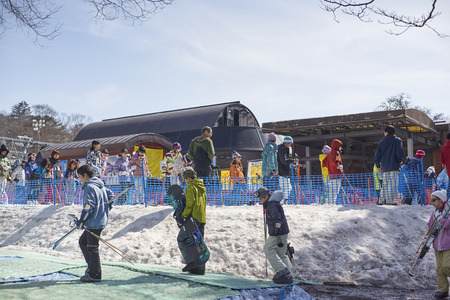 pampers: Karuizawa,Japan - 30,March,2015 : Tourists Lining up for skiing. Karuizawa is one of the few ski resorts in Japan . Conveniently located just minutes from the bullet train station and ski area, Karuizawa Prince Hotel pampers you with deluxe service and am Editorial