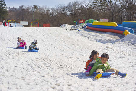 pampers: Karuizawa,Japan - 30,March,2015 : Kids having fun on the ski slopes . Karuizawa is one of the few ski resorts in Japan. Conveniently located just minutes from the bullet train station and ski area, Karuizawa Prince Hotel pampers you with deluxe service an