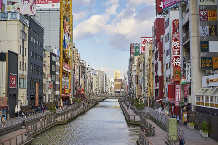 characterized: OSAKA,JAPAN - 25 March,2015: Dotonbori canal during daytime . it is now a popular nightlife and entertainment area characterized by its eccentric atmosphere and large illuminated signboards.