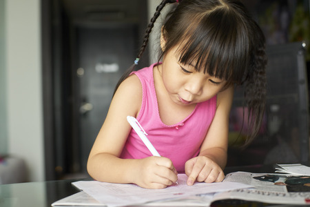 asian hair: a little girl learning to write