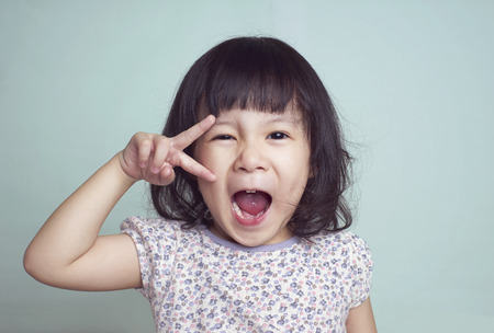 expressive: Portrait of young cute girl Stock Photo